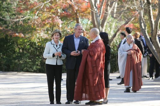 President George W. Bush and Laura Bush are welcomed to Bulguksa Temple by Juji Sunim, the chief monk, during their visit Thursday, Nov. 17, 2005, to Gyeongju, Korea. White House photo by Shealah Craighead