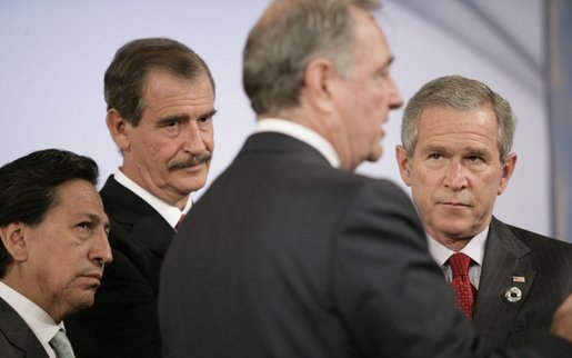 Canada's Prime Minister Paul Joseph Martin has the attention of President George W. Bush and fellow leaders of the Americas Friday, Nov. 18, 2005, as they meet at the Chosun Westin Hotel in Busan, Korea. Listening are, from left: Peru President Alejandro Toledo and Mexico President Vincente Fox. White House photo by Eric Draper