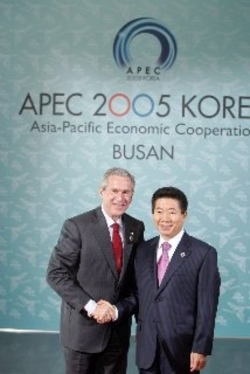 President George W. Bush shakes hands with President Moo Hyun Roh of the Republic of Korea as President Roh welcomes him to the 2005 APEC conference in Busan. White House photo by Paul Morse