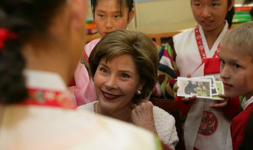 Laura Bush listens to children in the Children's Reading Room of the Busan Simin Metropolitan Municipal Library Friday, Nov. 18, 2005, in Busan, Korea. White House photo by Shealah Craighead