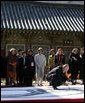 A calligrapher at the Beomeosa Temple in Busan entertains the spouses of APEC leaders Friday, Nov. 18, 2005, during the two-day summit. White House photo by Shealah Craighead