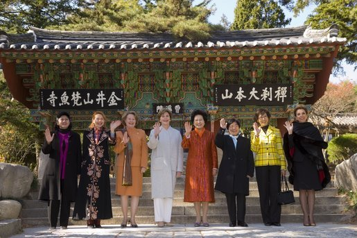 Other spouses of APEC leaders join Laura Bush Friday, Nov. 18, 2005, for a group photo at the Beomeosa Temple in Busan, Korea. White House photo by Shealah Craighead
