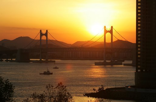The sun sets over Busan's Gwangan Grand Bridge Friday, Nov. 18, 2005. White House photo by Shealah Craighead