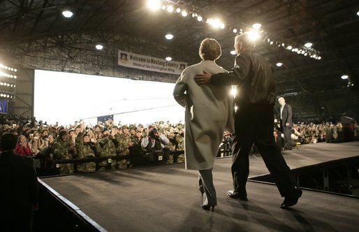 President George W. Bush and Laura Bush enter the Black Cat Hangar at Osan Air Base in Osan, Korea Saturday, Nov. 19, 2005, where the President made remarks to the troops before continuing his Asia tour. White House photo by Eric Draper
