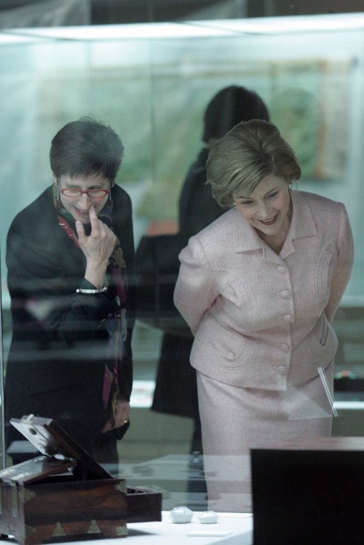 Laura Bush and Lisa Vershbow, left, wife of Alexander Vershbow, the U.S. Ambassador to Korea, look at exhibits at the Busan Museum Saturday, Nov. 19, 2005, in Busan, Korea. White House photo by Shealah Craighead
