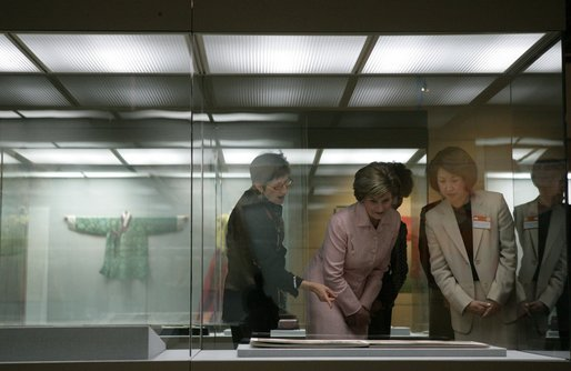 Laura Bush is joined by Lisa Vershbow, left, wife of U.S. Ambassador to Korea Alexander Vershbow, as they tour the Busan Museum Saturday, Nov. 19, 2005, in Busan, Korea. White House photo by Shealah Craighead