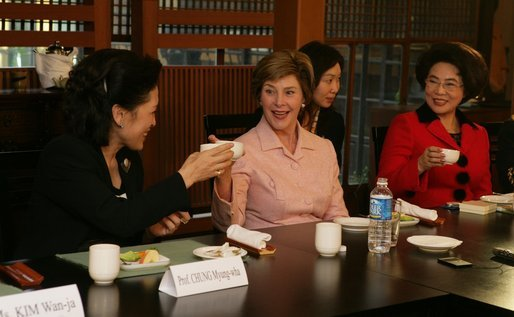 Mrs. Bush tips her teacup to Professor Chung Myung-wha during a discussion Saturday, Nov. 19, 2005, with women leaders in Busan, Korea. White House photo by Shealah Craighead