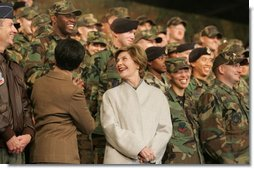 Laura Bush smiles back at the troops Saturday after she and the President stopped en route to China at Osan Air Base in Osan, Korea.  White House photo by Shealah Craighead