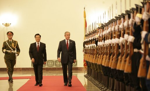 President George W. Bush and President Hu Jintao of the People's Republic of China, view Chinese troops during the welcome ceremonies for the President and Mrs. Bush at the Great Hall of People in Beijing. White House photo by Eric Draper