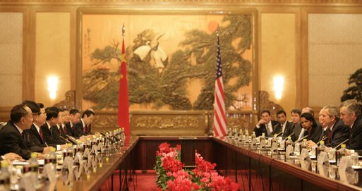 President George W. Bush and the U.S. delegation sit on the right as President Hu Jintao and his Chinese delegation sit on the opposite side during an expanded meeting Sunday, Nov. 20, 2005, at the Great Hall of the People in Beijing. White House photo by Eric Draper