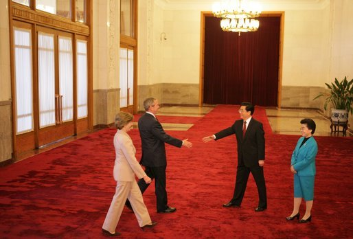 President and Mrs. Bush are greeted Sunday, Nov. 20, 2005, by China's President Hu Jintao and wife, Madame Liu, at the Great Hall of the People in Beijing. White House photo by Paul Morse