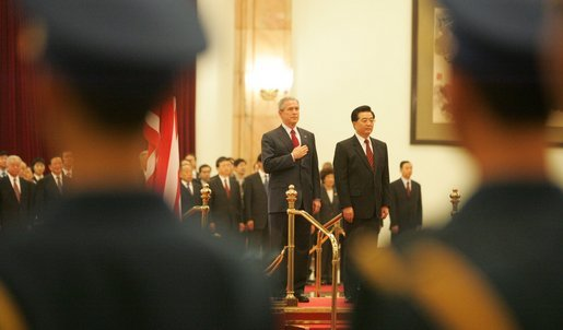 President George W. Bush and President Hu Jintao of China are viewed through the honor guard during welcoming ceremonies for the President and Mrs. Bush at the Great Hall of the People in Beijing. White House photo by Paul Morse