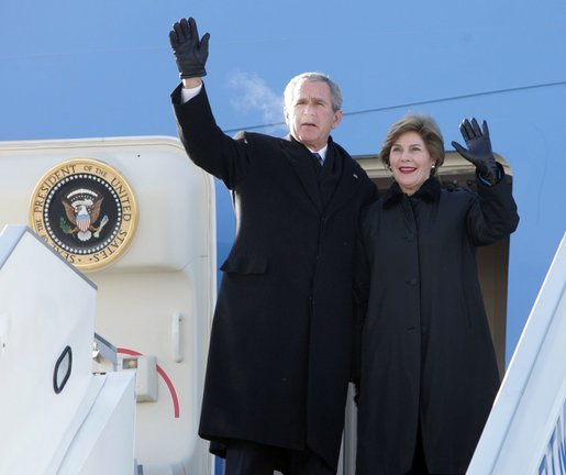 President and Mrs. Bush wave from the top of the steps as they deplane Air Force One Monday, Nov. 21, 2005, in Ulaanbaatar, Mongolia. The stop marks the first time a working U.S. president has visited the country. White House photo by Paul Morse