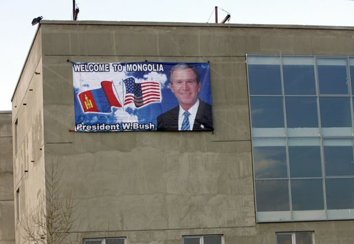"A sign welcoming ""George and Laura"" to Mongolia adorns a building at Buyant-Ukhaa Airport in Ulaanbaatar, Mongolia, as the President and First Lady arrived on the last stop of their Asia tour. White House photo by Paul Morse"