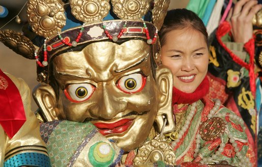 A participant in the cultural event for President and Mrs. Bush stands unmasked for photos Monday, Nov. 21, 2005, in Ikh Tenger, Mongolia. White House photo by Paul Morse