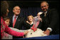 "President George W. Bush invites children on stage, Tuesday, November 22, 2005, to pet ""Marshmallow"", the National Thanksgiving Turkey, at the official pardoning of the turkey at the Eisenhower Executive Office Building in Washington. White House photo by David Bohrer"