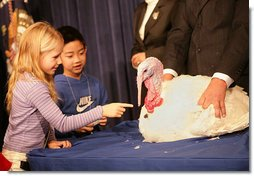 "President George W. Bush invites the children of Clarksville Elementary School on stage to pet ""Marshmallow"", the National Thanksgiving Turkey, during the Tuesday, November 22, 2005 pardoning ceremony, held in the Eisenhower Executive Office Building in Washington.  White House photo by Shealah Craighead"