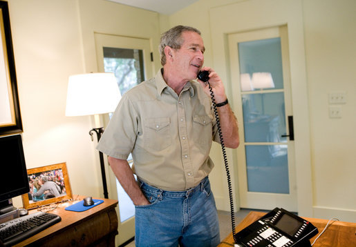 President George W. Bush calls troops from his ranch in Crawford, Texas, Thanksgiving Day, Thursday, Nov. 24, 2005. White House photo by Eric Draper