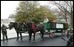 A U.S. Park Service officer helps guide a horse drawn carriage delivering the official White House Christmas tree, Monday, Nov. 28, 2005. This year's tree, donated by the Deal Family of Smokey Holler Tree Farm in Laurel Springs, N.C., is the 40th year the National Christmas Tree Growers Association has provided a tree to the White House. White House photo by Shealah Craighead