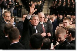 "President Bush waves to the crowd after delivering an emphatic statement on the War on Terror Wednesday, Nov. 30, 2005, at the U.S. Naval Academy in Annapolis. ""Victory in Iraq will demand the continued determination and resolve of the American people,"" said the President.  White House photo by Paul Morse"