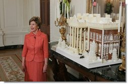 Laura Bush stands before the White House gingerbread house, Wednesday, Nov. 30, 2005, as she answers questions during the press preview of the White House Christmas decorations.  White House photo by Shealah Craighead