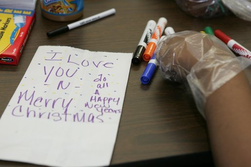 A personal note is written on a sandwich bag by a student Wednesday, Nov. 30, 2005 during a visit to the Church of the Epiphany in Washington by Laura Bush, as part of her Helping America's Youth initiative. The students, part of the Youth Service Learning Project, were preparing sandwiches for the homeless. White House photo by Shealah Craighead