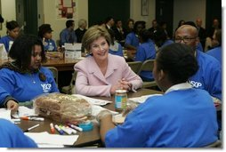 Laura Bush talks with students Wednesday, Nov. 30, 2005 during a visit to the Church of the Epiphany in Washington, as part of her Helping America's Youth initiative, where the students, part of the Youth Service Learning Project, were preparing sandwiches to feed the homeless.  White House photo by Shealah Craighead