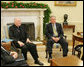 President George W. Bush meets with Theodore Cardinal McCarrick, Archbishop of Washington, Thursday, Dec. 1, 2005, in the Oval Office at the White House. White House photo by Paul Morse