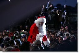 Santa goes into the audience to sing a song, Thursday evening, Dec. 1, 2005, during the Pageant of Peace and the lighting of the National Christmas Tree on the Ellipse in Washington.  White House photo by Paul Morse