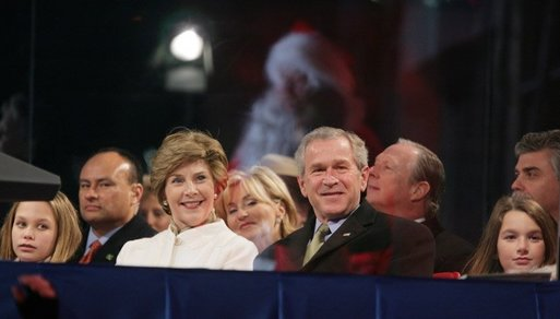 President George W. Bush and Laura Bush watch the holiday entertainment, Thursday evening, Dec. 1, 2005, during the Pageant of Peace and the lighting of the National Christmas Tree on the Ellipse in Washington. White House photo by Paul Morse