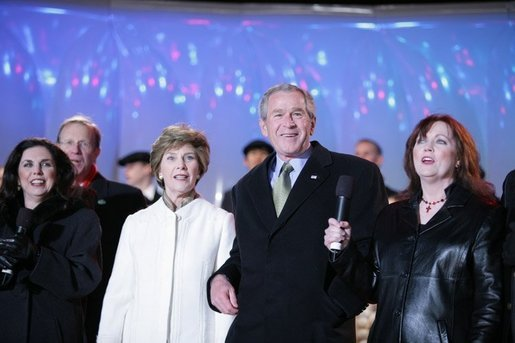 President George W. Bush and Laura Bush join holiday entertainers Thursday evening, Dec. 1, 2005, on stage during the Pageant of Peace and lighting of the National Christmas Tree festivities on the Ellipse in Washington. White House photo by Paul Morse