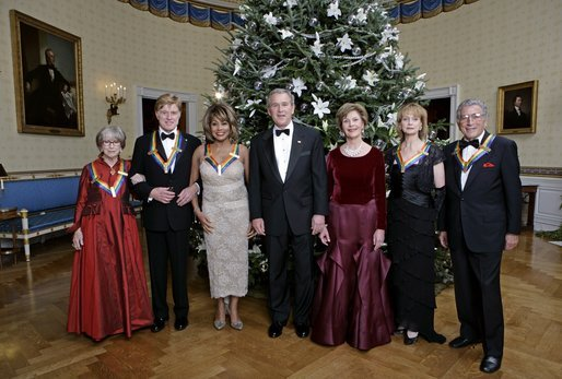 President George W. Bush and Laura Bush pose with the Kennedy Center honorees, from left to right, actress Julie Harris, actor Robert Redford, singer Tina Turner, ballet dancer Suzanne Farrell and singer Tony Bennett, Sunday, Dec. 4, 2005, during the reception in the Blue Room at the White House. White House photo by Eric Draper