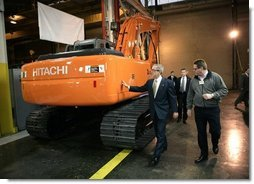 President George W. Bush tours the John Deere-Hitachi excavator assembly line, Monday, Dec. 5, 2005 with operations manager Ron Morrison, prior to his remarks on the economy and tax relief to an audience in Kernersville, N.C.  White House photo by Eric Draper