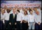President George W. Bush greets workers following his remarks on the economy and tax relief in Kernersville, N.C., where he toured the John Deere-Hitachi excavator assembly line, Monday, Dec. 5, 2005. White House photo by Eric Draper