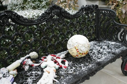 As Barney and Miss Beazley frolic among the holiday decorations, their toys are left outside in the snow Monday, Dec. 5, 2005. White House photo by Shealah Craighead