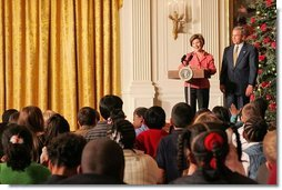 Laura and President Bush welcome children to the White House's Children's Holiday Reception in the East Room Monday, Dec. 5, 2005.  White House photo by Shealah Craighead