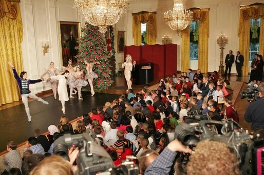 "Sitting with children, President and Laura Bush watch the American Ballet Company perform part of the Holiday classic, ""The Nutcracker,"" during the Children's Holiday Reception in the East Room Monday, Dec. 5, 2005. White House photo by Shealah Craighead"