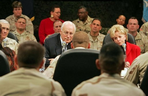 Vice President Dick Cheney and Lynne Cheney sit down and talk with troops from the 42nd Infantry at Fort Drum, N.Y., Tuesday, Dec. 6, 2005. White House photo by David Bohrer