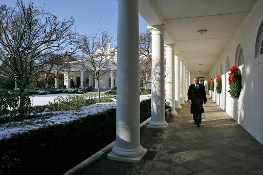 President George W. Bush takes a brisk walk along the colonnade in the Rose Garden Friday morning, Dec. 9, 2005. White House photo by Kimberlee Hewitt