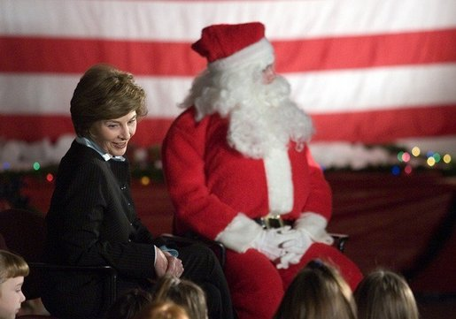 "Laura Bush talks with a group of children as she visits the Naval and Marine Corps Reserve Center in Gulfport, Miss., Monday, Dec. 12, 2005, where she showed them White House holiday video featuring the Bush's dogs ""Barney and Miss Beazley."" White House photo by Shealah Craighead"