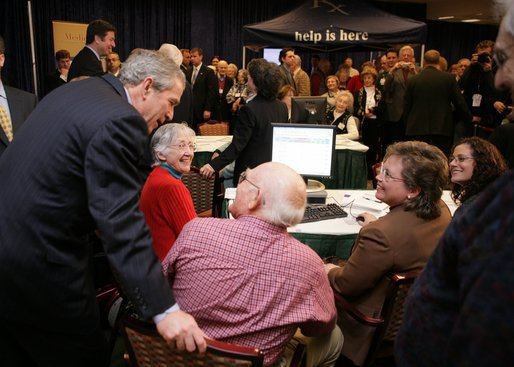 President Bush leans over to view a computer screen as he visits with participants Tuesday, Dec. 13, 2005, at the Medicare Prescription Drug Educational and Enrollment Event at the Greenspring Village Retirement Community in Springfield, Va. White House photo by Paul Morse