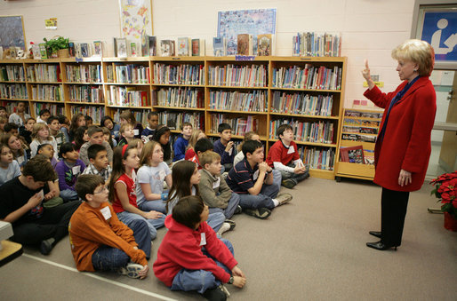 Mrs. Cheney holds up her finger as she describes to students at W.W. Burrows Elementary School in Quantico the procedure for casting votes in the upcoming parliamentary elections in Iraq and its importance. Mrs. Cheney spoke to the kids Tuesday, Dec. 13, 2005, on the U.S. Marine Corps base. White House photo by David Bohrer