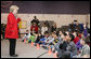 Students at Fort Belvoir Elementary School fill the gymnasium Tuesday, Dec. 13, 2005, for a visit by Mrs. Lynne Cheney. Mrs. Cheney spoke with the kids about the importance of the upcoming Iraqi elections and likened the parliamentary procedure to that of America's in its own early struggle for democracy. White House photo by David Bohrer