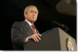"President Bush acknowledges applause during his remarks on the War on Terror Wednesday, Dec. 14, 2005, at the Woodrow Wilson International Center for Scholars in Washington D.C. Speaking of this week's elections in Iraq, President Bush told the audience, ""We are living through a watershed moment in the story of freedom.""  White House photo by Kimberlee Hewitt"