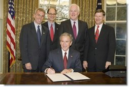 President George W. Bush is joined in the Oval Office, from left to right, by U.S. Rep. Todd Platts, R-Pa., U.S. Rep. Brad Sherman, D-Calif., U.S. Senator John Cornyn, R-Texas, and U.S. Rep. Lamar Smith, R-Texas, at the signing Wednesday, Dec. 14, 2005 of the Executive Order Improving Agency Disclosure of Information.  White House photo by Paul Morse