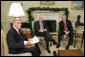 President George W. Bush meets with U.S. Senator John McCain, R-Ariz., and U.S. Senator John Warner, R-Va., Thursday, Dec. 15, 2005 in the Oval Office, to discuss the U.S. position on the interrogation of prisoners. White House photo by Paul Morse