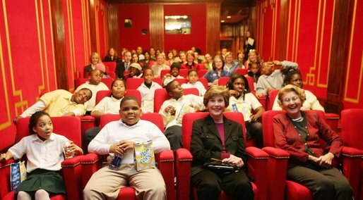 Students and their mentors from Everybody Wins! DC, a community-based mentoring program, joined Mrs. Laura Bush and her mother, Mrs. Jenna Welch, to watch C.S.Lewis' The Chronicles of Narnia: The Lion, The Witch, and The Wardrobe in the White House Theater. The students are from Robert Brent Elementary Schoool and the John Tyler Elementary School in Washington, D.C. Also in attendance were Mr. Douglas Gresham, stepson of C.S. Lewis; Ms. Mary Salander, executive director, Everybody Wins! DC; Ms. Pat Schroeder, president, American Publishing Association and Mr. Michael Flaherty, co-founder and president, Walden Media. White House photo by Shealah Craighead