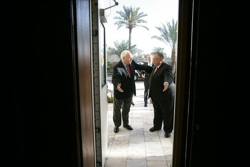 Vice President Dick Cheney and Iraqi President Jalal Talibani enter a meeting with Ambassador to Iraq Zalmay Khalilzad inside the Green Zone, Sunday Dec. 18, 2005. White House photo by David Bohrer