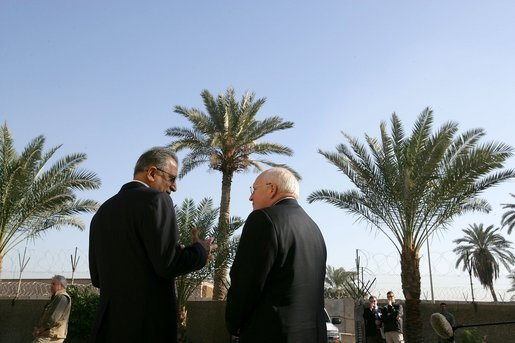 Vice President Dick Cheney speaks with Zalmay Khalilzad, US Ambassador to Iraq, inside the Green Zone, Sunday Dec. 18, 2005. White House photo by David Bohrer