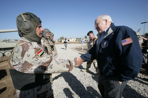 Vice President Dick Cheney visits the 9th Mechanized Infantry Division HQ at Taji Air Base to greet Iraqi troops and view tanks and armored vehicles they have refurbished into working fighting vehicles, Sunday Dec. 18, 2005. White House photo by David Bohrer